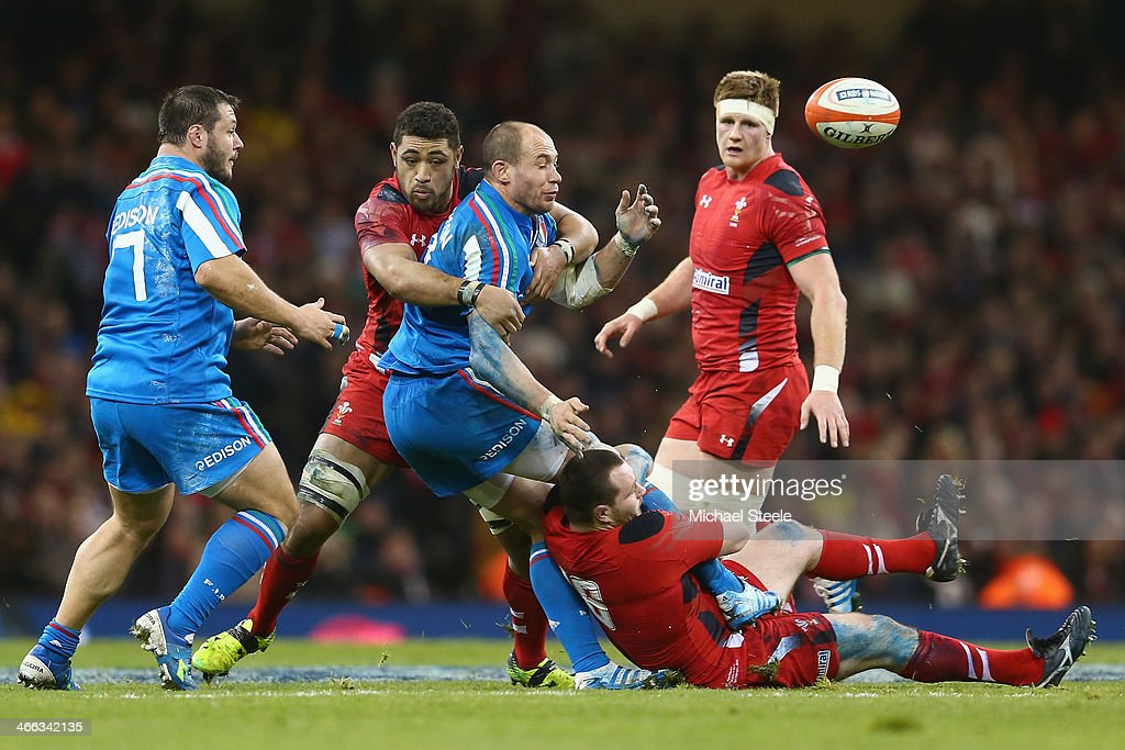 Sergio Parisse of Italy offloads as Taulupe Faletau and Ken Owens of Wales challenge during the RBS Six Nations match between Wales and Italy at the...
