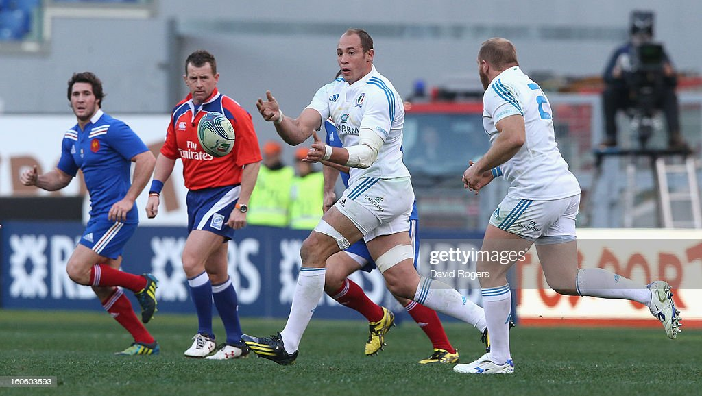 <a gi-track='captionPersonalityLinkClicked' href=/galleries/search?phrase=Sergio+Parisse&family=editorial&specificpeople=648570 ng-click='$event.stopPropagation()'>Sergio Parisse</a> of Italy passes the ball during the RBS Six Nations match between Italy and France at Stadio Olimpico on February 3, 2013 in Rome, Italy.