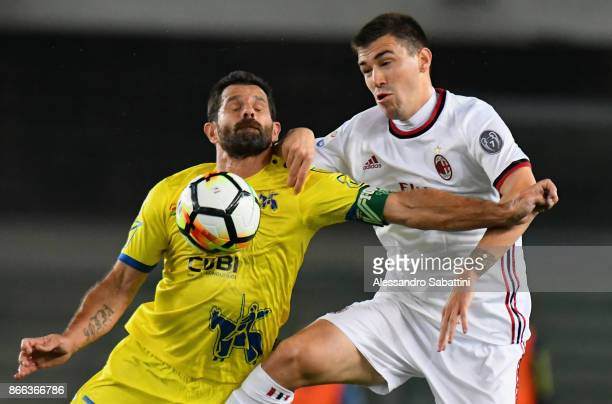 Sergio Pellissier AC Chievo Verona competes for the ball whit Alessio Romagnoli of AC Milan during the Serie A match between AC Chievo Verona and AC...