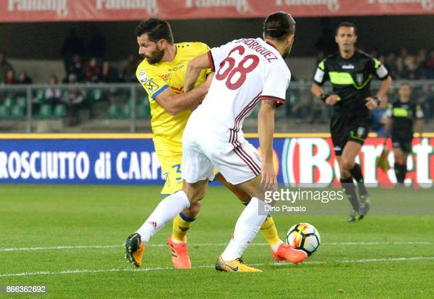 Sergio Pellissier of AC Chievo Verona competes with Ricardo Rodrguez of AC Milan during the Serie A match between AC Chievo Verona and AC Milan at...