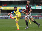 Sergio Pellissier of AC Chievo Verona is challenged by Alex Dias da Costa of AC Milan during the Serie A match between AC Chievo Verona and AC Milan...