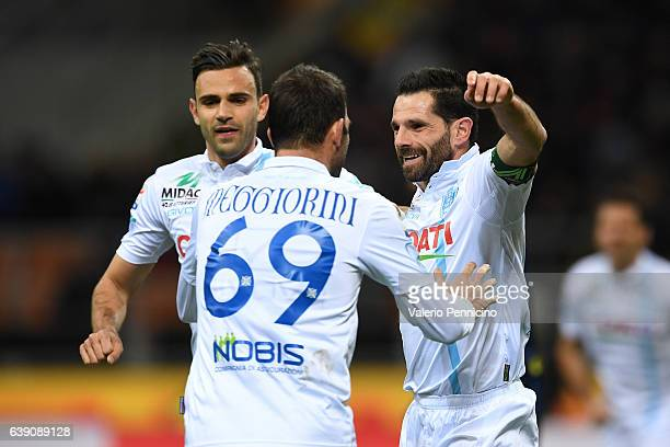 Sergio Pellissier of AC ChievoVerona celebrates after scoring the opening goal with team mates during the Serie A match between FC Internazionale and...