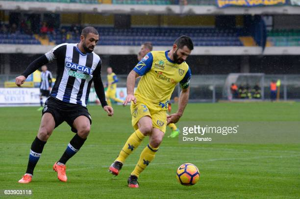 Sergio Pellissier of AC ChievoVerona competes with Danilo Larangeira of Udinese Calcio during the Serie A match between AC ChievoVerona and Udinese...