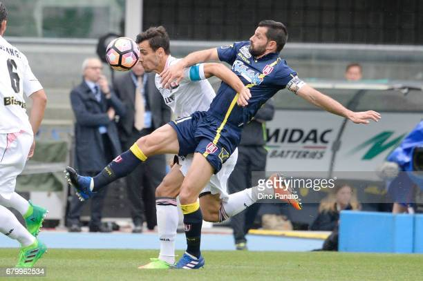 Sergio Pellissier of AC ChievoVerona competes with Giancarlo Gonzalez of US Citta di Palermo during the Serie A match between AC ChievoVerona and US...