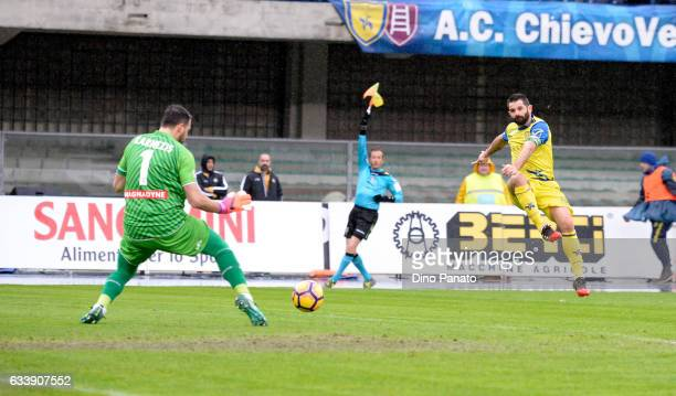 Sergio Pellissier of AC ChievoVerona competes with Orestis Karnezis goalkeeper of Udinese Calcio during the Serie A match between AC ChievoVerona and...