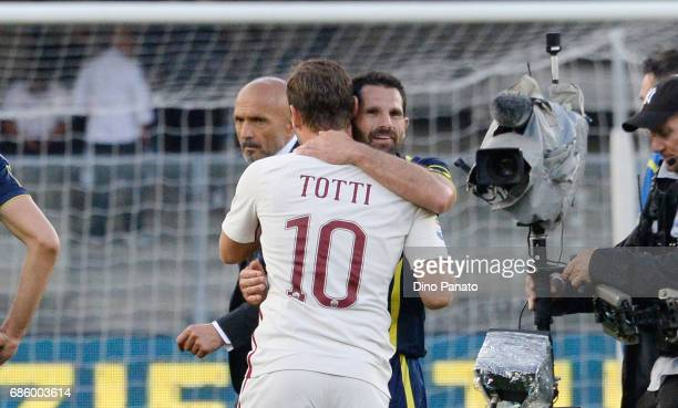 Sergio Pellissier of AC ChievoVerona shakes hands with with Francesco Totti of AS Roma during the Serie A match between AC ChievoVerona and AS Roma...