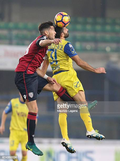 Sergio Pellissier of Chievo competes for the ball in air with Luca Ceppitelli of Cagliari during the Serie A match between AC ChievoVerona and...