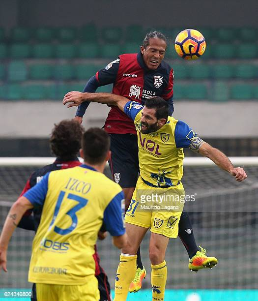 Sergio Pellissier of Chievo competes for the ball in the air with Bruno Alves of Cagliari during the Serie A match between AC ChievoVerona and...