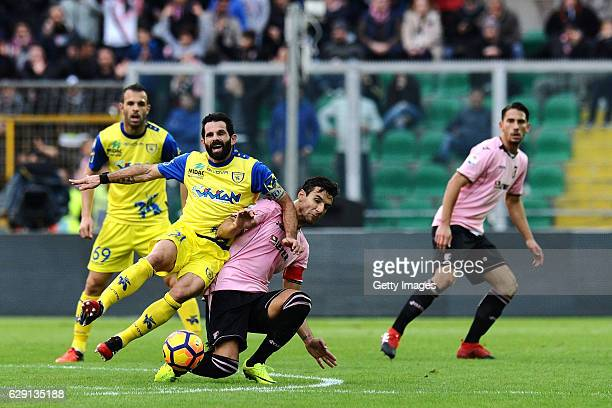Sergio Pellissier of Chievo Verona and Sinisa Andelkovic of Palermo fight for the ball during the Serie A match between US Citta di Palermo and AC...