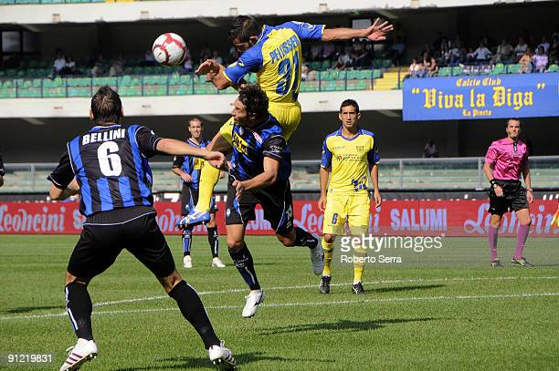 Sergio Pellissier of Chievo Verona competes the ball to Federico Peluso of Atalanta BC during the Serie A match between Chievo Verona and Atalanta BC...