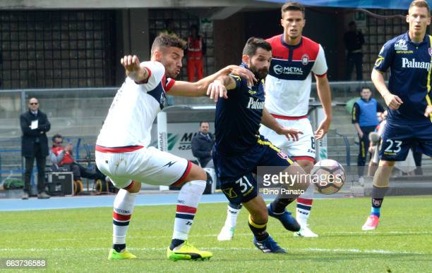 Sergio Pellissier of ChievoVerona competes with Gianmarco Ferrari of Crotone during the Serie A match between AC ChievoVerona and FC Crotone at...