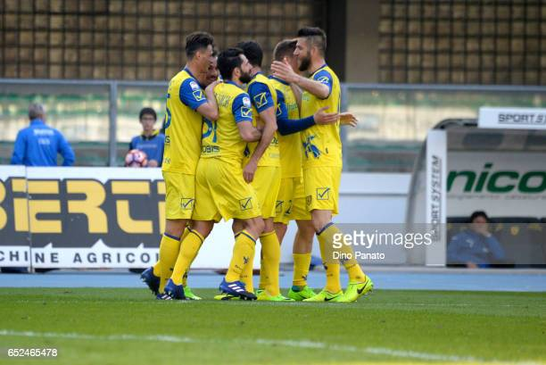 Sergio Pellissier of ChievoVerona is mobbed by teammates after scoring his team's second goal during the Serie A match between AC ChievoVerona and...
