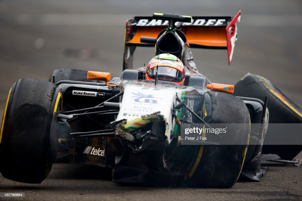 Sergio Perez of Force India and Mexico crashes out of the Hungarian F1 Grand Prix at Hungaroring on July 27, 2014 in Budapest, Hungary.