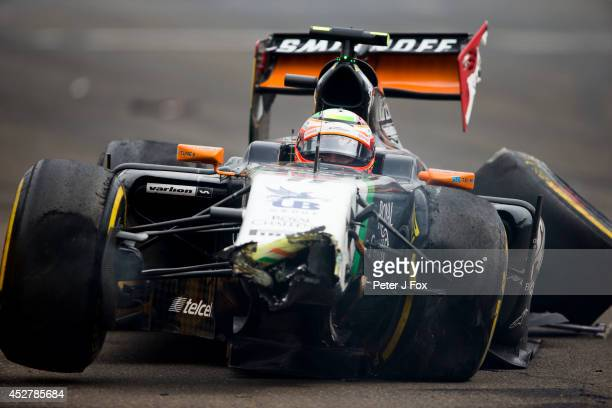 Sergio Perez of Force India and Mexico crashes out of the Hungarian F1 Grand Prix at Hungaroring on July 27 2014 in Budapest Hungary