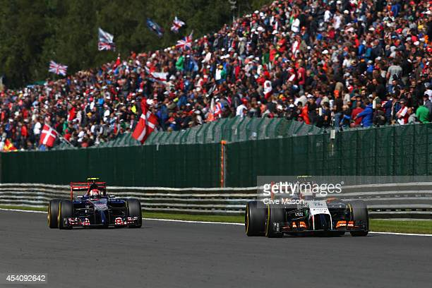 Sergio Perez of Mexico and Force India and Daniil Kvyat of Russia and Scuderia Toro Rosso drive during the Belgian Grand Prix at Circuit de...