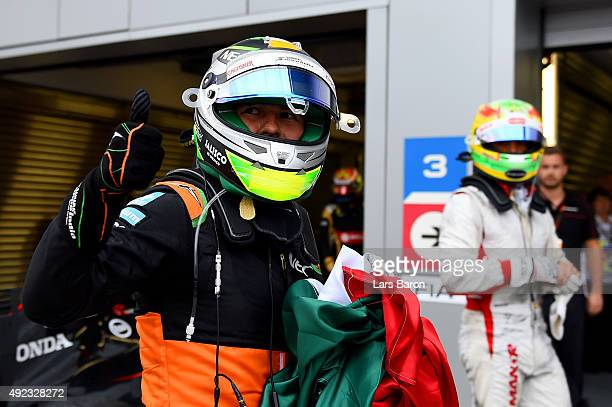 Sergio Perez of Mexico and Force India celebrates in Parc Ferme after finishing third in the Formula One Grand Prix of Russia at Sochi Autodrom on...