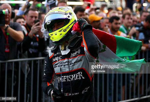 Sergio Perez of Mexico and Force India celebrates in parc ferme with his team after finishing third in the European Formula One Grand Prix at Baku...