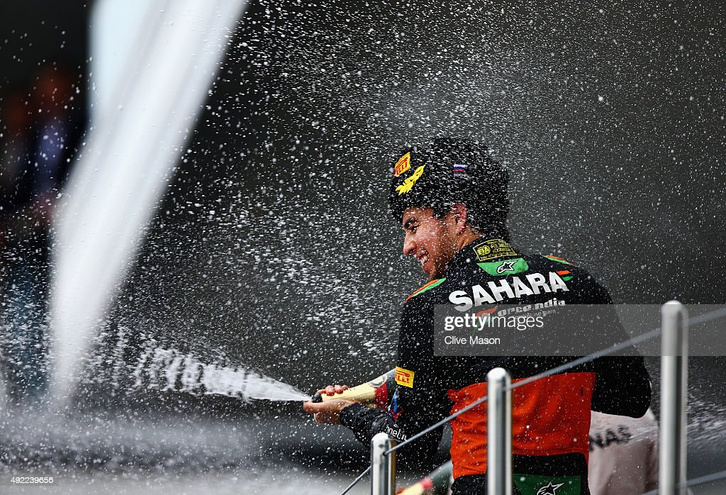 Sergio Perez of Mexico and Force India celebrates on the podium after finishing third in the Formula One Grand Prix of Russia at Sochi Autodrom on October 11, 2015 in Sochi, Russia.