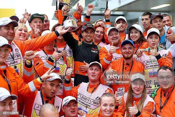 Sergio Perez of Mexico and Force India celebrates with course marshalls after finishing third in the Formula One Grand Prix of Russia at Sochi...