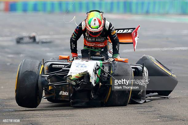 Sergio Perez of Mexico and Force India gets out of his car after crashing during the Hungarian Formula One Grand Prix at Hungaroring on July 27 2014...