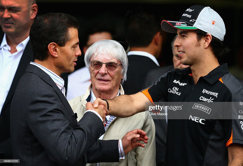 Sergio Perez of Mexico and Force India greets the President of Mexico, Enrique Pena Nieto next to F1 supremo Bernie Ecclestone outside the Force India garage during previews to the Formula One Grand Prix of Mexico at Autodromo Hermanos Rodriguez on October 29, 2015 in Mexico City, Mexico.