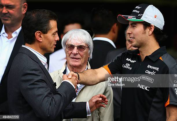 Sergio Perez of Mexico and Force India greets the President of Mexico Enrique Pena Nieto next to F1 supremo Bernie Ecclestone outside the Force India...