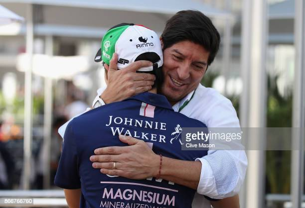 Sergio Perez of Mexico and Force India meets Chilean football legend Ivan Zamorano in the Paddock during previews to the Formula One Grand Prix of...