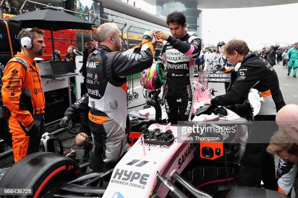 Sergio Perez of Mexico and Force India prepares on the grid during the Formula One Grand Prix of China at Shanghai International Circuit on April 9...