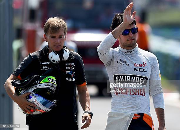 Sergio Perez of Mexico and Force India returns to the pit lane after crashing during practice for the Formula One Grand Prix of Hungary at...