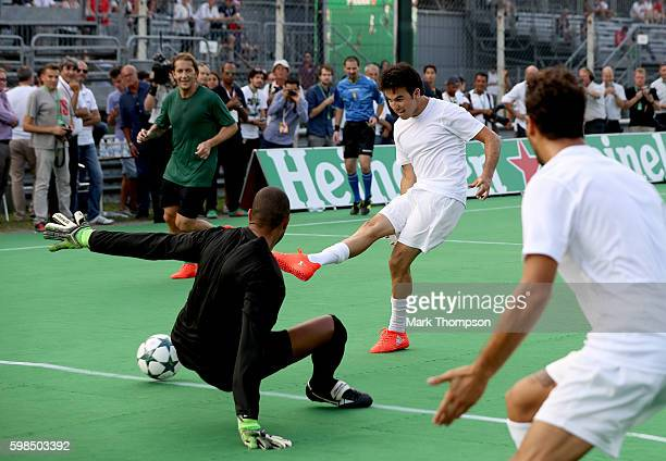 Sergio Perez of Mexico and Force India shoots past Dida of Brazil during the Heineken Champions of the Grid Charity football match during previews...