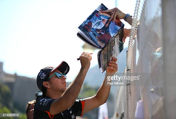 Sergio Perez of Mexico and Force India signs autographs for fans in the paddock during previews to the Monaco Formula One Grand Prix at Circuit de...
