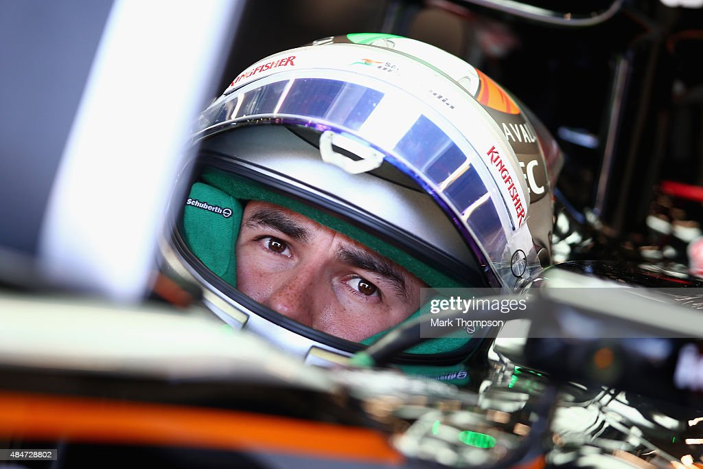 Sergio Perez of Mexico and Force India sits in his car in the garage during practice for the Formula One Grand Prix of Belgium at Circuit de Spa-Francorchamps on August 21, 2015 in Spa, Belgium.