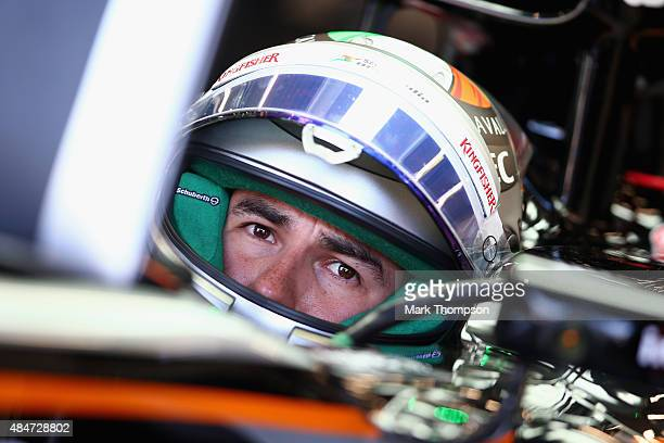 Sergio Perez of Mexico and Force India sits in his car in the garage during practice for the Formula One Grand Prix of Belgium at Circuit de...