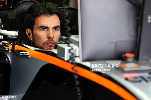 Sergio Perez of Mexico and Force India sits in his car in the garage during final practice for the Formula One Grand Prix of Great Britain at...