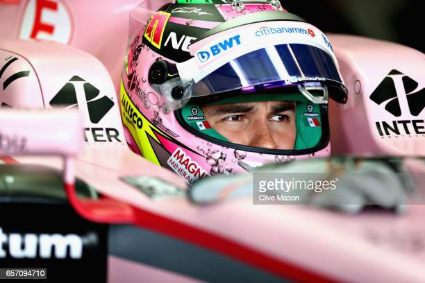 Sergio Perez of Mexico and Force India sits in his car in the garage during practice for the Australian Formula One Grand Prix at Albert Park on...
