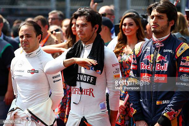 Sergio Perez of Mexico and Force India stands for the national anthem on the grid before the Formula One Grand Prix of Mexico at Autodromo Hermanos...