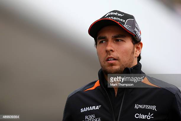 Sergio Perez of Mexico and Force India walks in the paddock during practice for the Formula One Grand Prix of Japan at Suzuka Circuit on September 25...