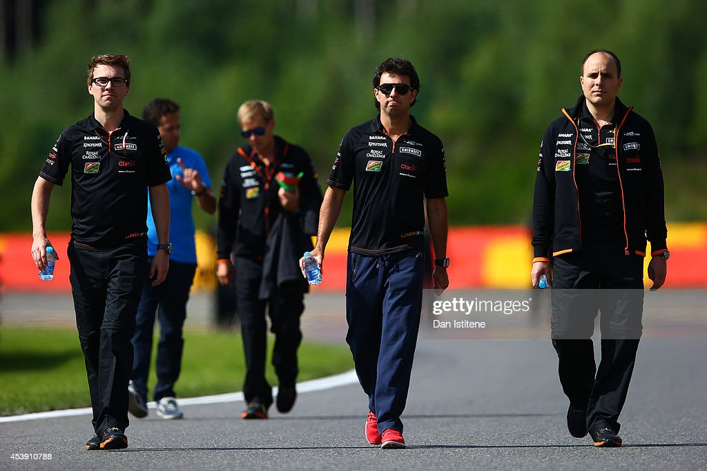 Sergio Perez of Mexico and Force India walks the track with members of his team during previews ahead of the Belgian Grand Prix at Circuit de Spa-Francorchamps on August 21, 2014 in Spa, Belgium.