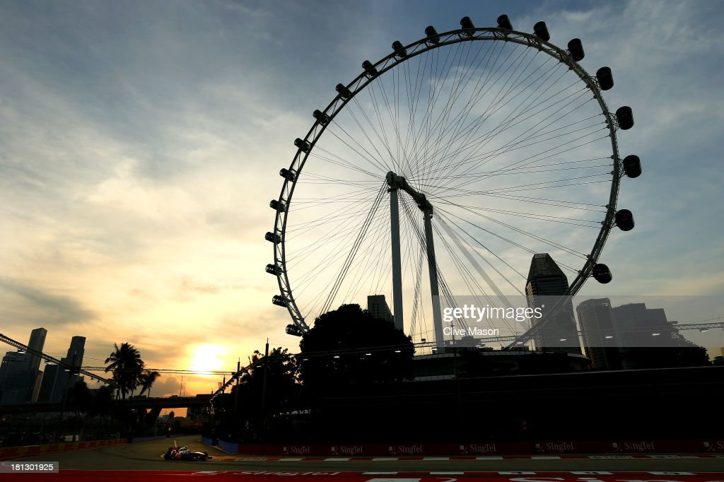 Sergio Perez of Mexico and McLaren drives during practice for the Singapore Formula One Grand Prix at Marina Bay Street Circuit on September 20, 2013 in Singapore, Singapore.