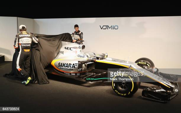 Sergio Perez of Mexico and Sahara Force India and Esteban Ocon of France and Sahara Force India unveil the VJM10 car during the Sahara Force India...