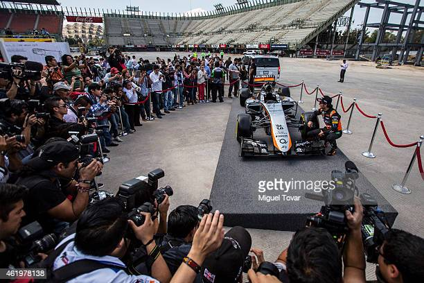 Sergio Perez poses for pictures during a walk through the Hermanos Rodriguez Racing Circuit Facilities on January 22 2015 in Mexico City Mexico The...
