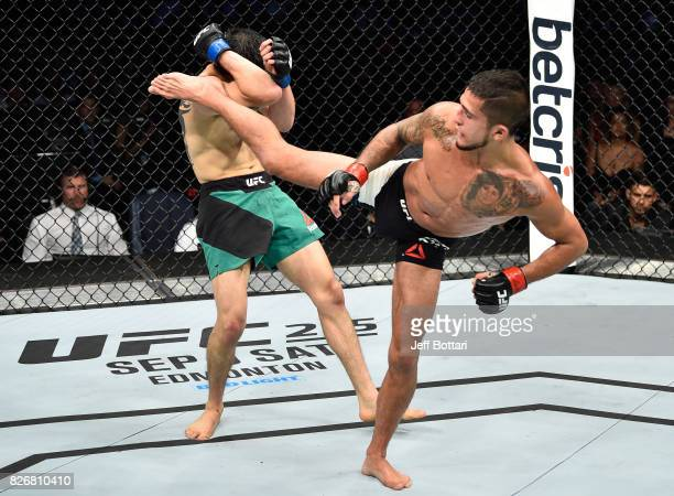 Sergio Pettis kicks Brandon Moreno of Mexico in their flyweight bout during the UFC Fight Night event at Arena Ciudad de Mexico on August 5 2017 in...
