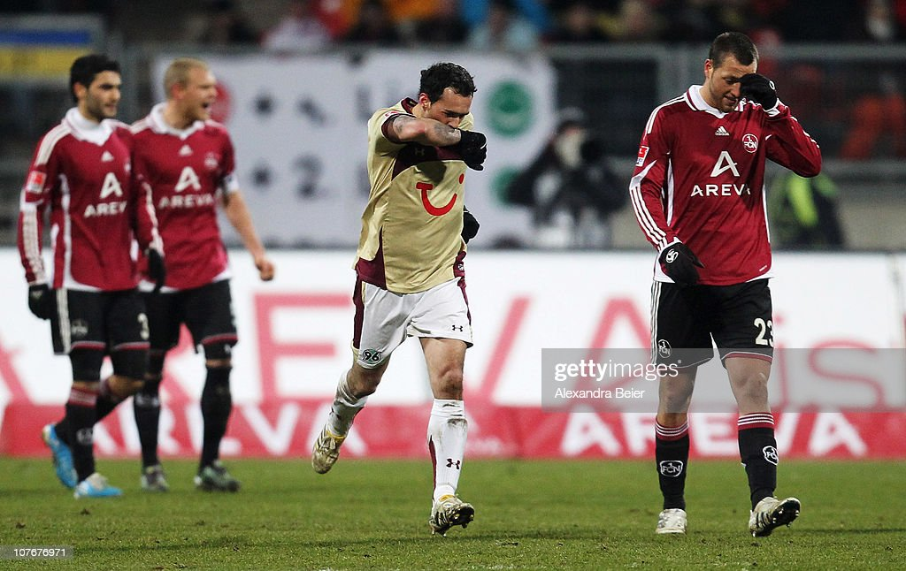 <a gi-track='captionPersonalityLinkClicked' href=/galleries/search?phrase=Sergio+Pinto&family=editorial&specificpeople=683636 ng-click='$event.stopPropagation()'>Sergio Pinto</a> (2ndR) of Hannover celebrates his penalty goal as Nuernberg players react during the Bundesliga match between 1. FC Nuernberg and Hannover 96 at Easy Credit Stadium on December 18, 2010 in Nuremberg, Germany.