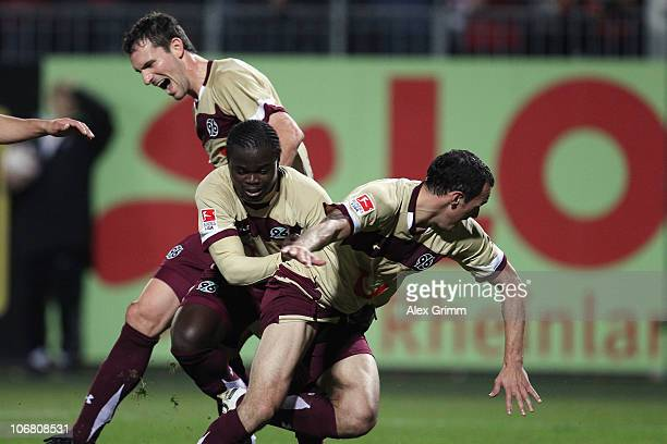 Sergio Pinto of Hannover celebrates his team's first goal with team mates Didier Ya Konan and Mario Eggimann during the Bundesliga match between FSV...