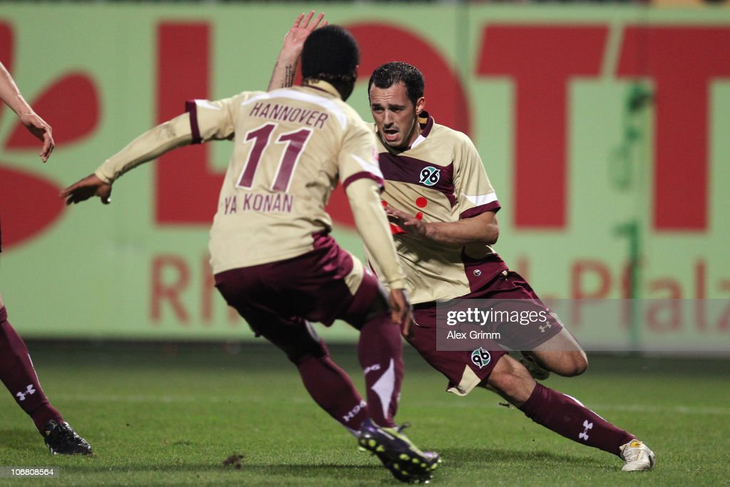<a gi-track='captionPersonalityLinkClicked' href=/galleries/search?phrase=Sergio+Pinto&family=editorial&specificpeople=683636 ng-click='$event.stopPropagation()'>Sergio Pinto</a> (back) of Hannover celebrates his team's first goal with team mate Didier Ya Konan during the Bundesliga match between FSV Mainz 05 and Hannover 96 at the Bruchweg Stadium on November 13, 2010 in Mainz, Germany.