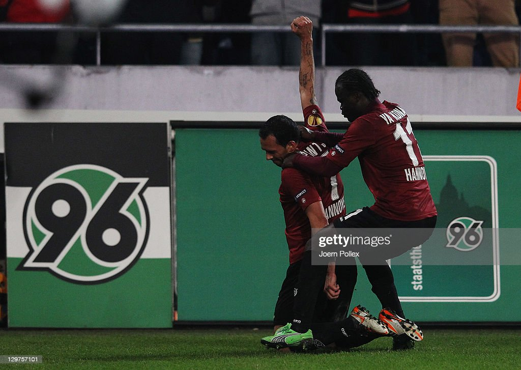 <a gi-track='captionPersonalityLinkClicked' href=/galleries/search?phrase=Sergio+Pinto&family=editorial&specificpeople=683636 ng-click='$event.stopPropagation()'>Sergio Pinto</a> ( L) of Hannover celebrates with his team mate Didier Ya Konan after scoring his team's second goal during the UEFA Europa League Group B match between Hannover 96 and FC Kobenhavn at AWD Arena on October 20, 2011 in Hannover, Germany.