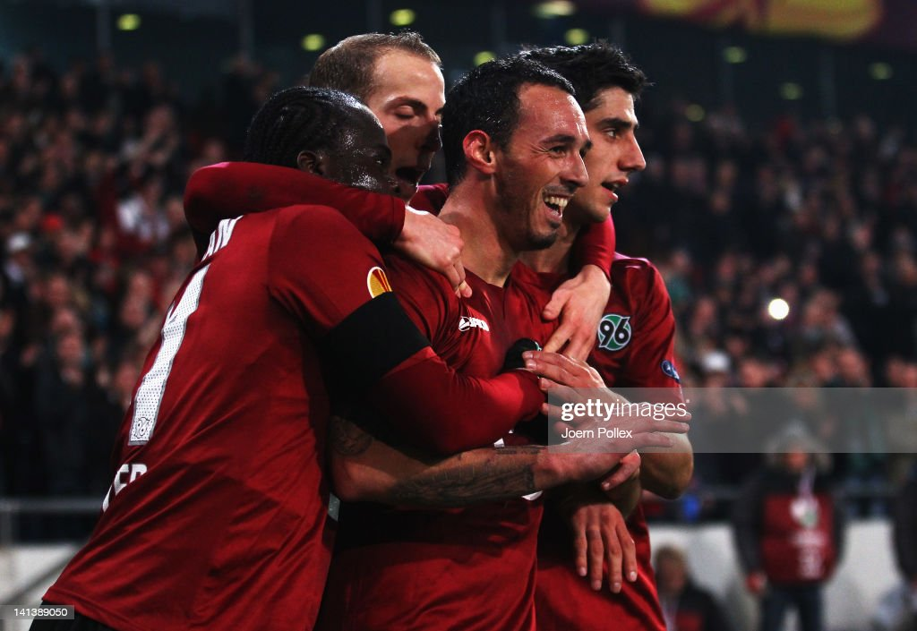 <a gi-track='captionPersonalityLinkClicked' href=/galleries/search?phrase=Sergio+Pinto&family=editorial&specificpeople=683636 ng-click='$event.stopPropagation()'>Sergio Pinto</a> (R) of Hannover celebrates with his team mates after scoring his team's fourth goal during the UEFA Europa League second leg round of 16 match between Hannover 96 and Standard Liege at AWD Arena on March 15, 2012 in Hannover, Germany.