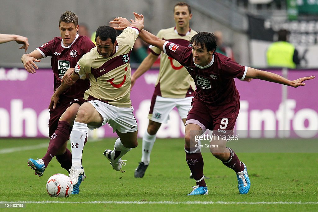 <a gi-track='captionPersonalityLinkClicked' href=/galleries/search?phrase=Sergio+Pinto&family=editorial&specificpeople=683636 ng-click='$event.stopPropagation()'>Sergio Pinto</a> (C) of Hannover is challenged by <a gi-track='captionPersonalityLinkClicked' href=/galleries/search?phrase=Ivo+Ilicevic&family=editorial&specificpeople=535662 ng-click='$event.stopPropagation()'>Ivo Ilicevic</a> (L) and <a gi-track='captionPersonalityLinkClicked' href=/galleries/search?phrase=Srdjan+Lakic&family=editorial&specificpeople=1792938 ng-click='$event.stopPropagation()'>Srdjan Lakic</a> (R) of Kaiserslautern during the Bundesliga match between 1. FC Kaiserslautern and Hannover 96 at the Fritz-Walter Stadium on September 26, 2010 in Kaiserslautern, Germany.