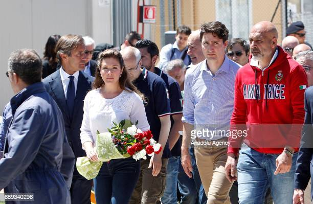 Sergio Pirozzi Mayor of the quakehit town of Amatrice accompanies Canada's Prime Minister Justin Trudeau and his wife Sophie Gregoire during their...