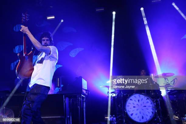 Sergio Pizzorno and drummer Ian Matthews of Kasabian perform live on stage at The Forum on April 18 2017 in London United Kingdom